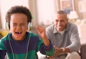 getty_rf_photo_of_son_listening_to_headphones